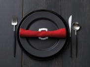 Expecting dinner guests? A pair of fangs to hold together dinner napkins helps complete your Halloween tablescape. Via Food Network.