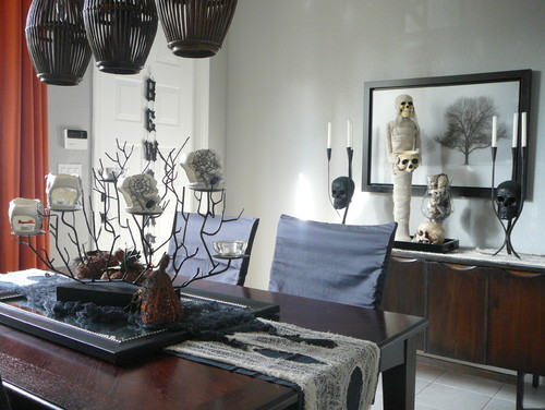 Make your dining room spooky with a black and white themed tablescape. Via Houzz: http://www.houzz.com/photos/39302/Fall---Halloween-Tablescape-modern-dining-room-miami
